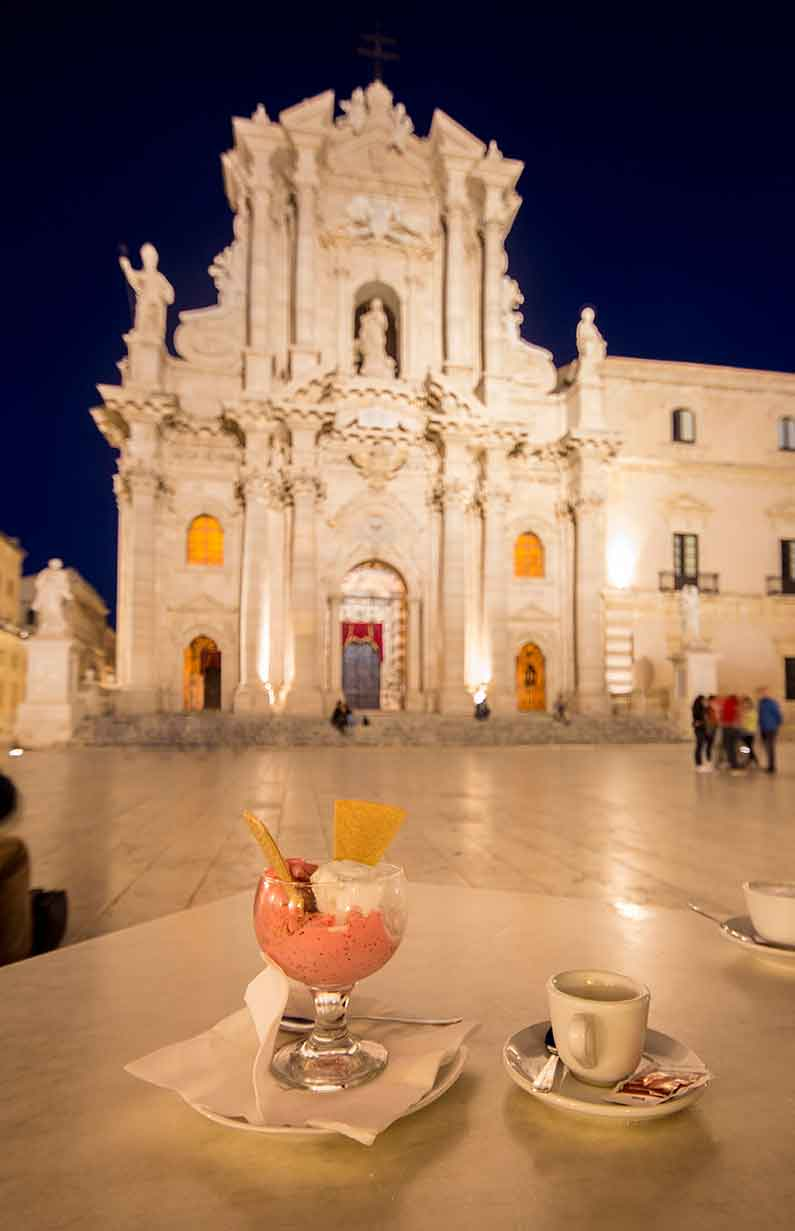 Ortigia Sicily eating gelato in the piazza del duomo