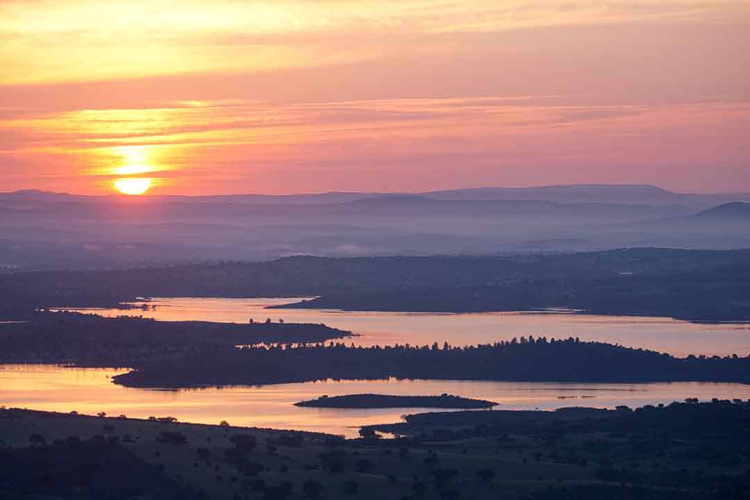 Image of sunrise over the Barragem da Alqueva lakes from Monsaraz, Portugal