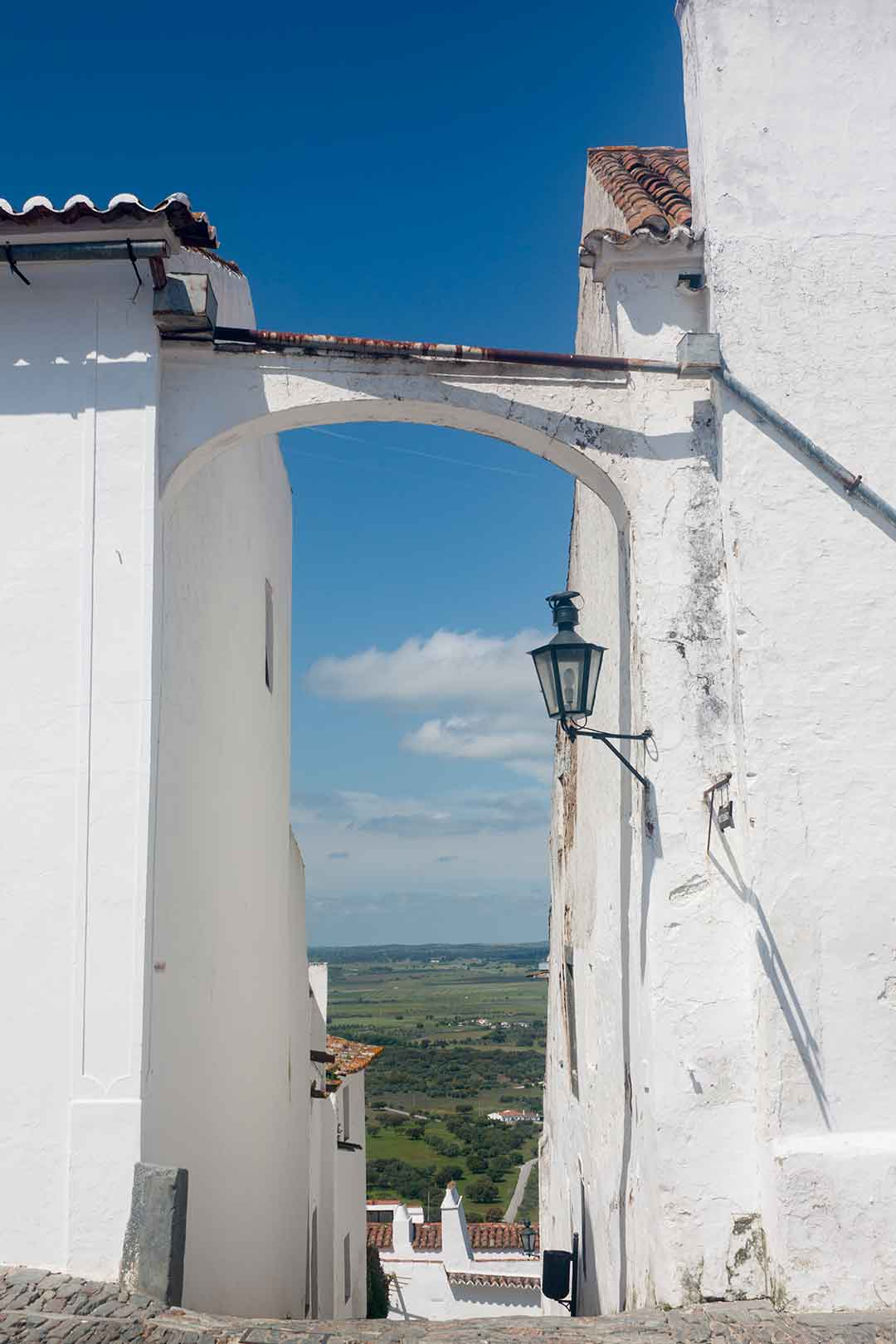 Image of an alleyway in Monsaraz, portugal, looking out over the plain below