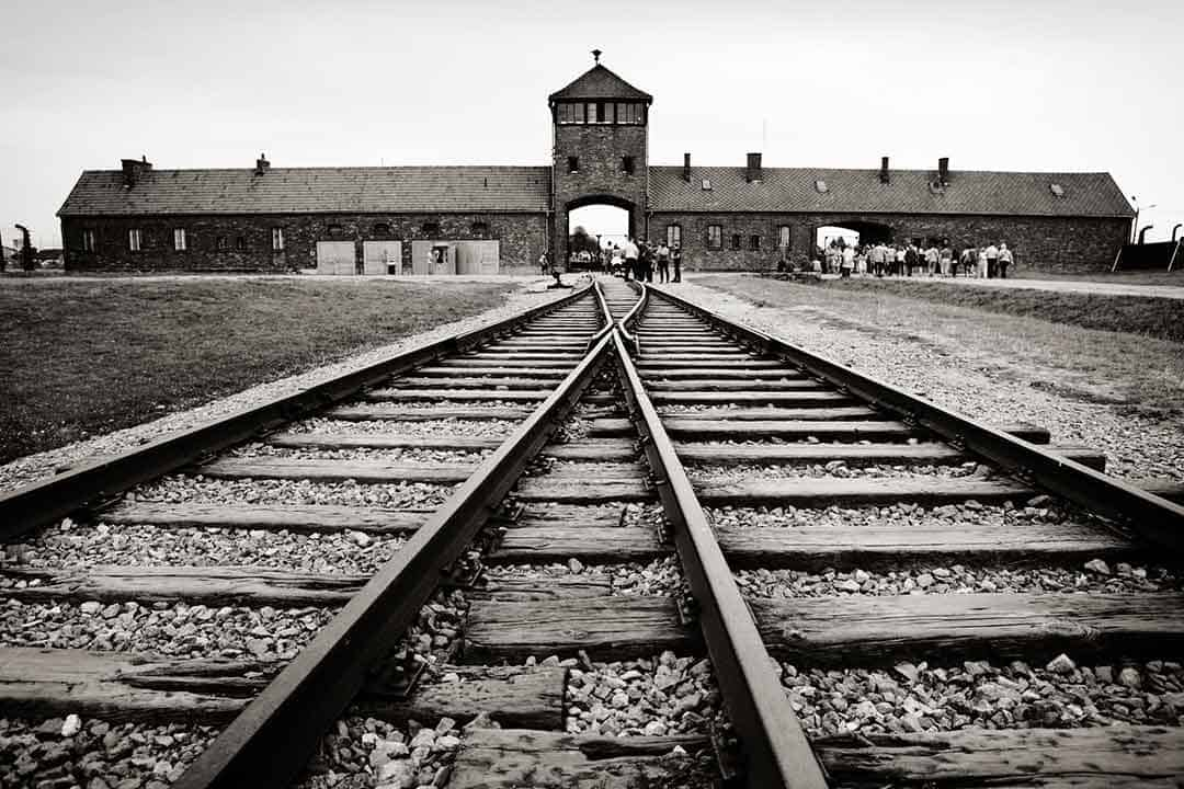 Image of the gate of death at Auschwitz-Birkenau