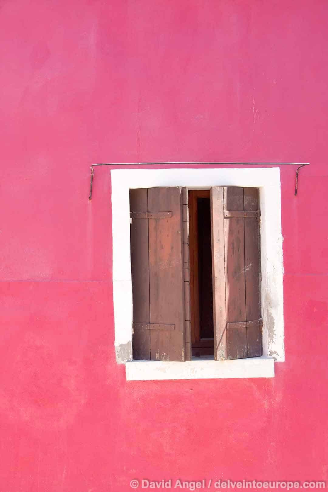 Image of pink house and white bordered window, Burano, Venice, Italy