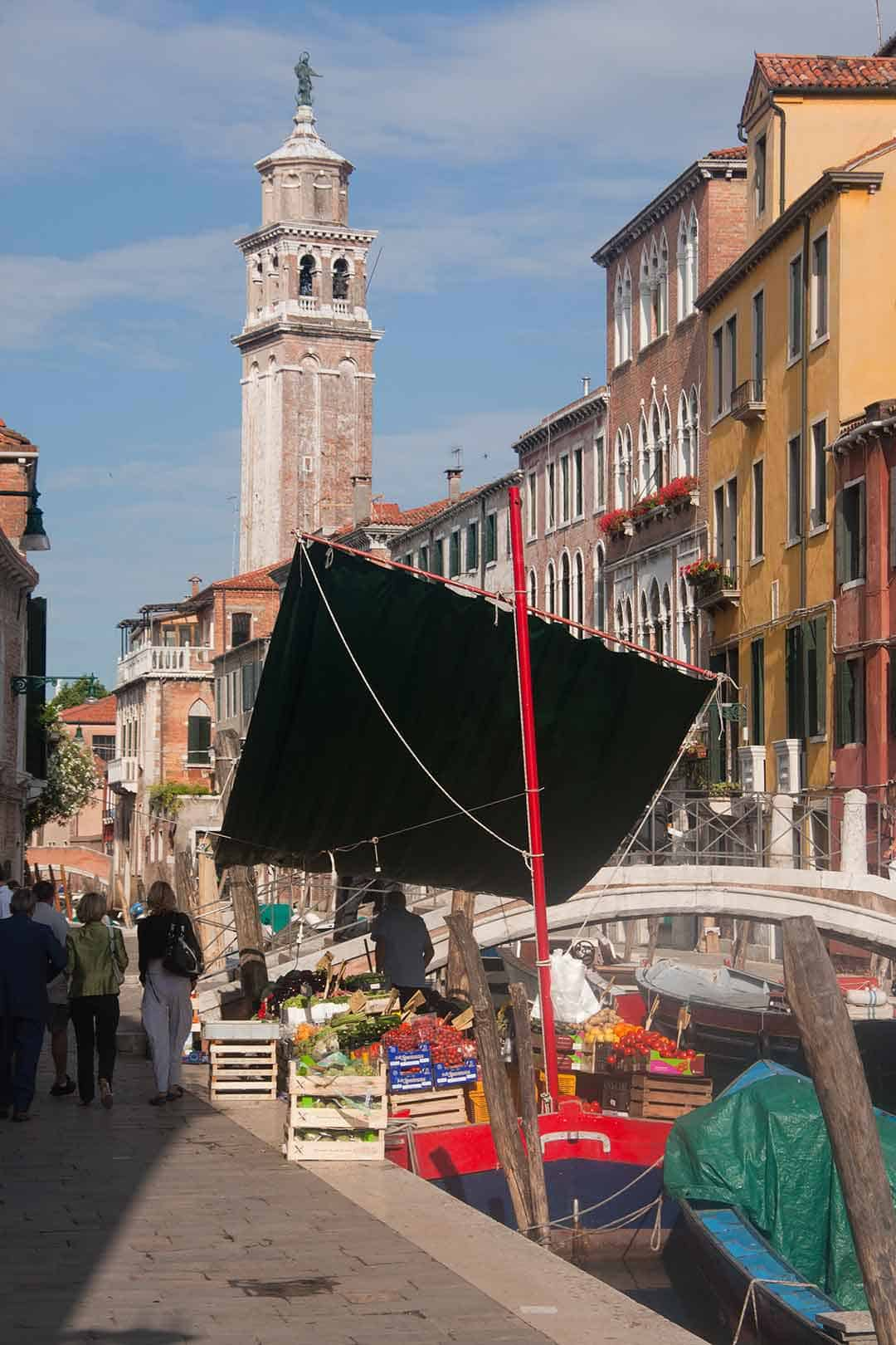 Image of fruit and vegetable stall on boat in canal in Venice Italy