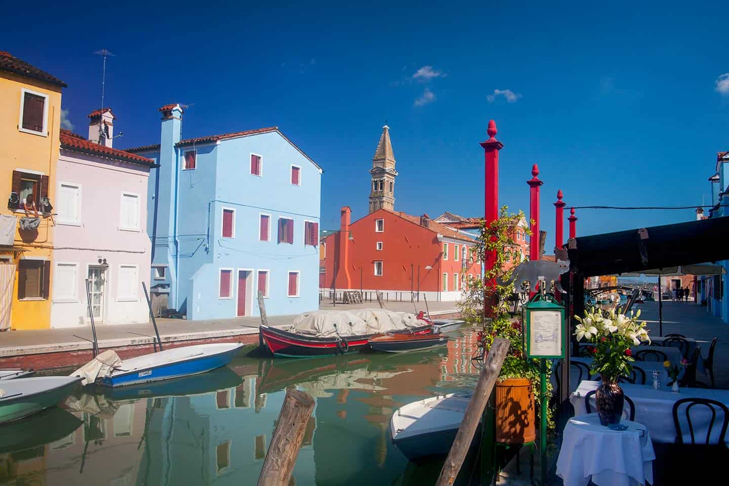 Best things to do Venice Image of restaurant and canal on island of Burano