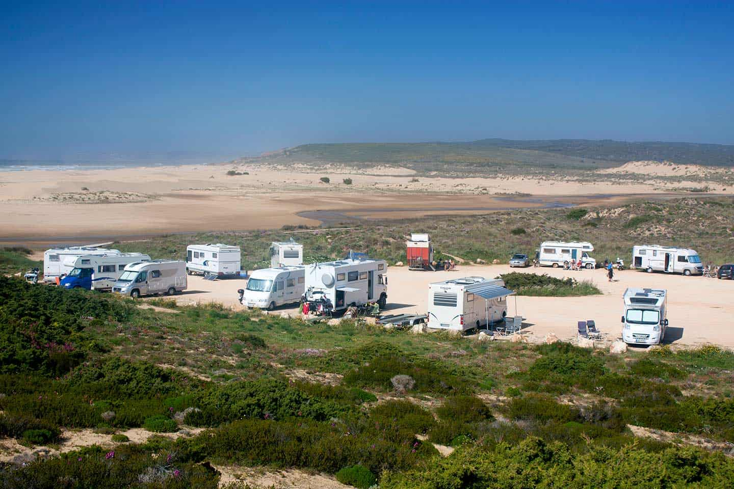 Camping Algarve Image of camper vans at Praia da Bordeira, Carrapateira