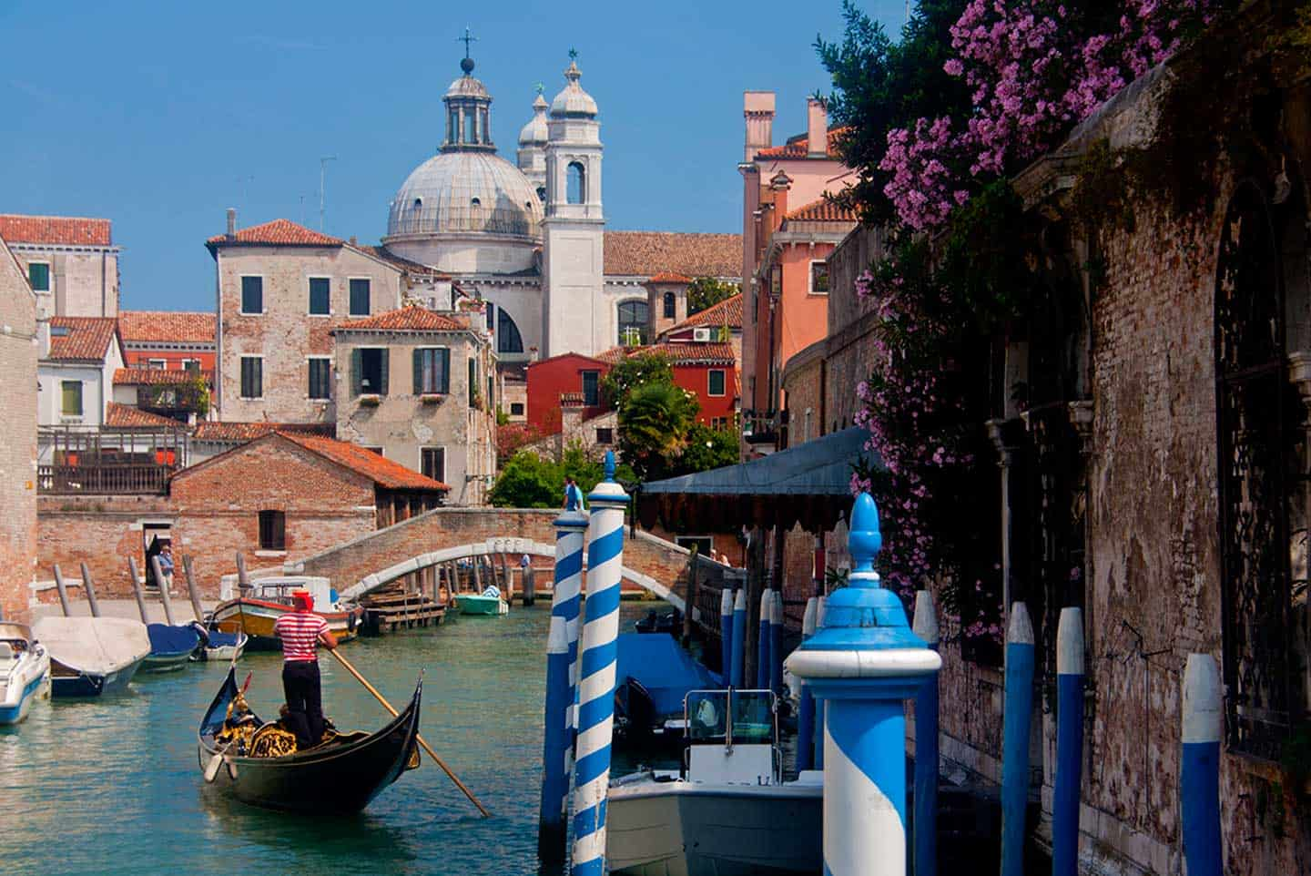 Image of gondola on canal with Gesuati church behind Venice Italy