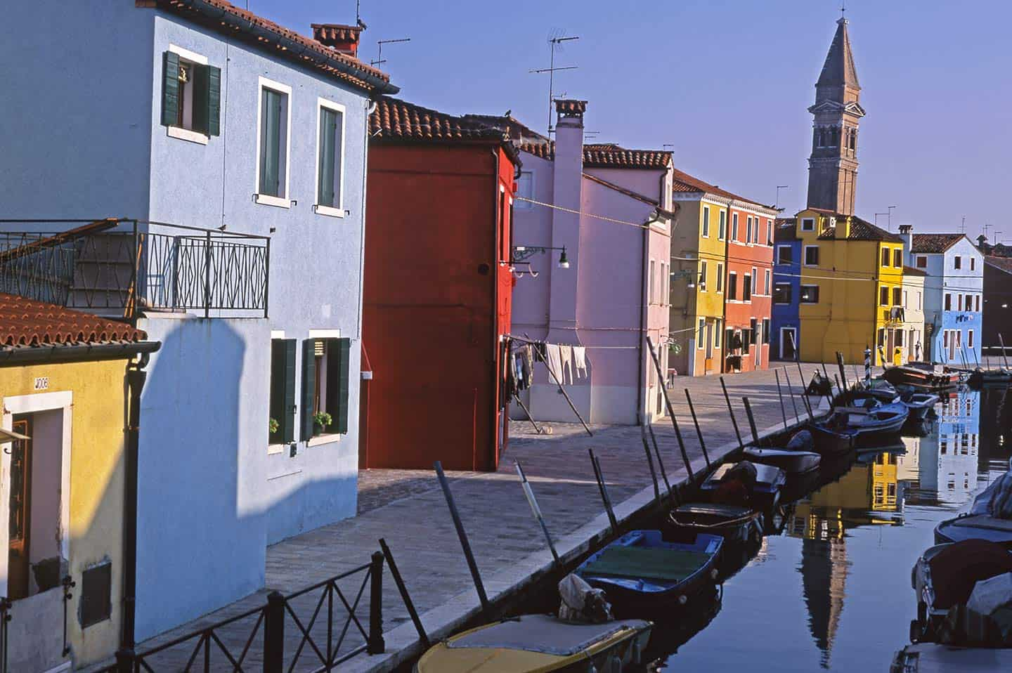 Image of canal, houses and church on Burano Island Venice