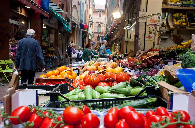 Bologna markets image of fresh produce stall in a Bologna street market