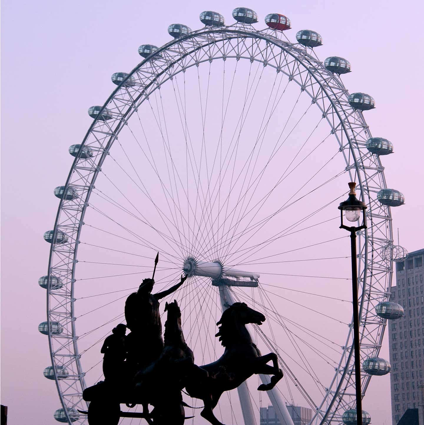 Image of Queen Boadicea and chariot statue, with the London Eye behind