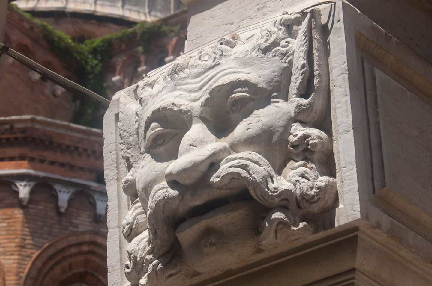 Image of a carved face on the Ospedaletto church in Venice