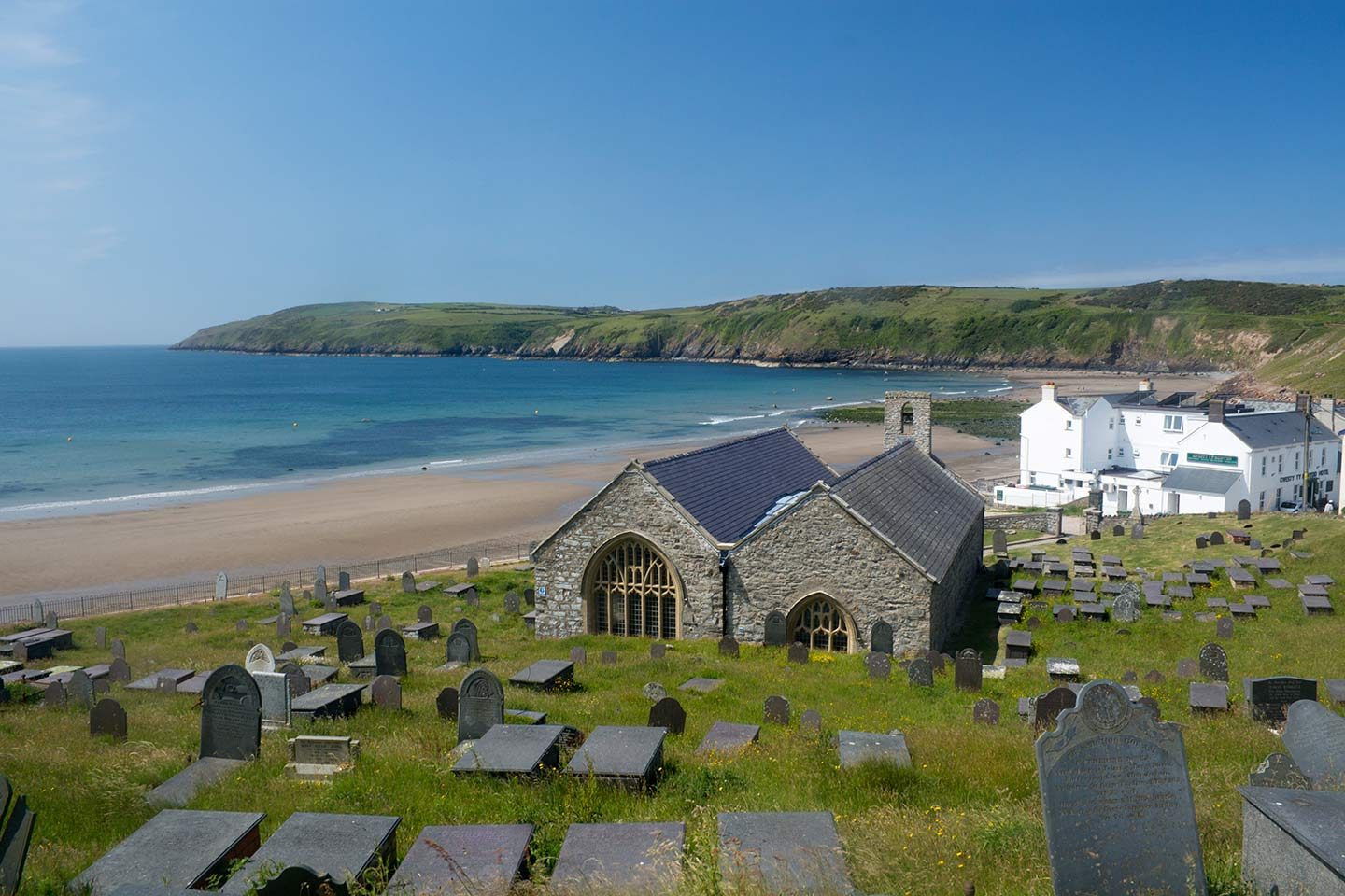Image of St Hywyn's Church, Aberdaron, and beach