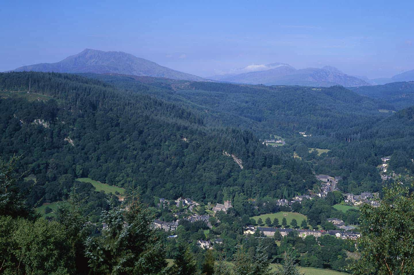 Image of Betws-y-Coed village and Snowdonia mountains