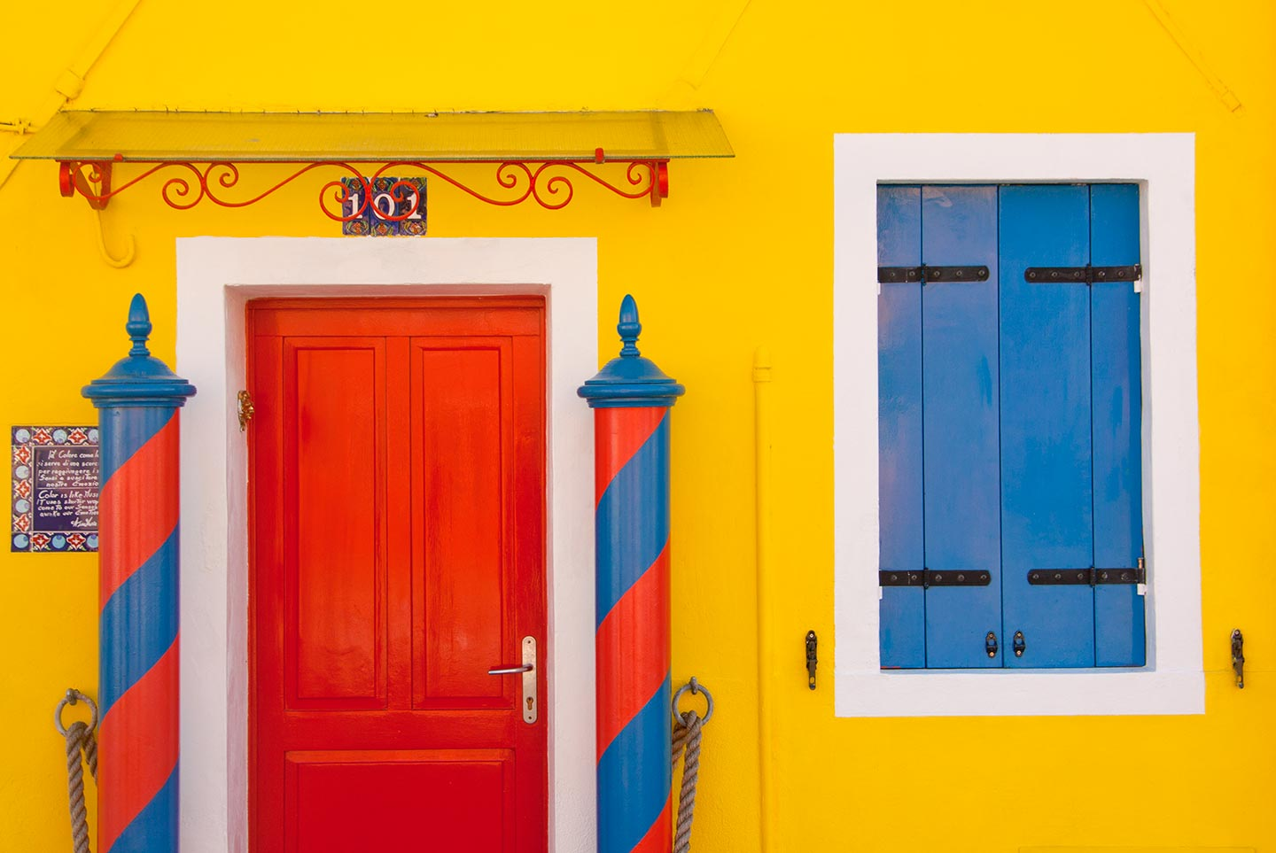 Image of a beautiful yellow house in Burano, Italy