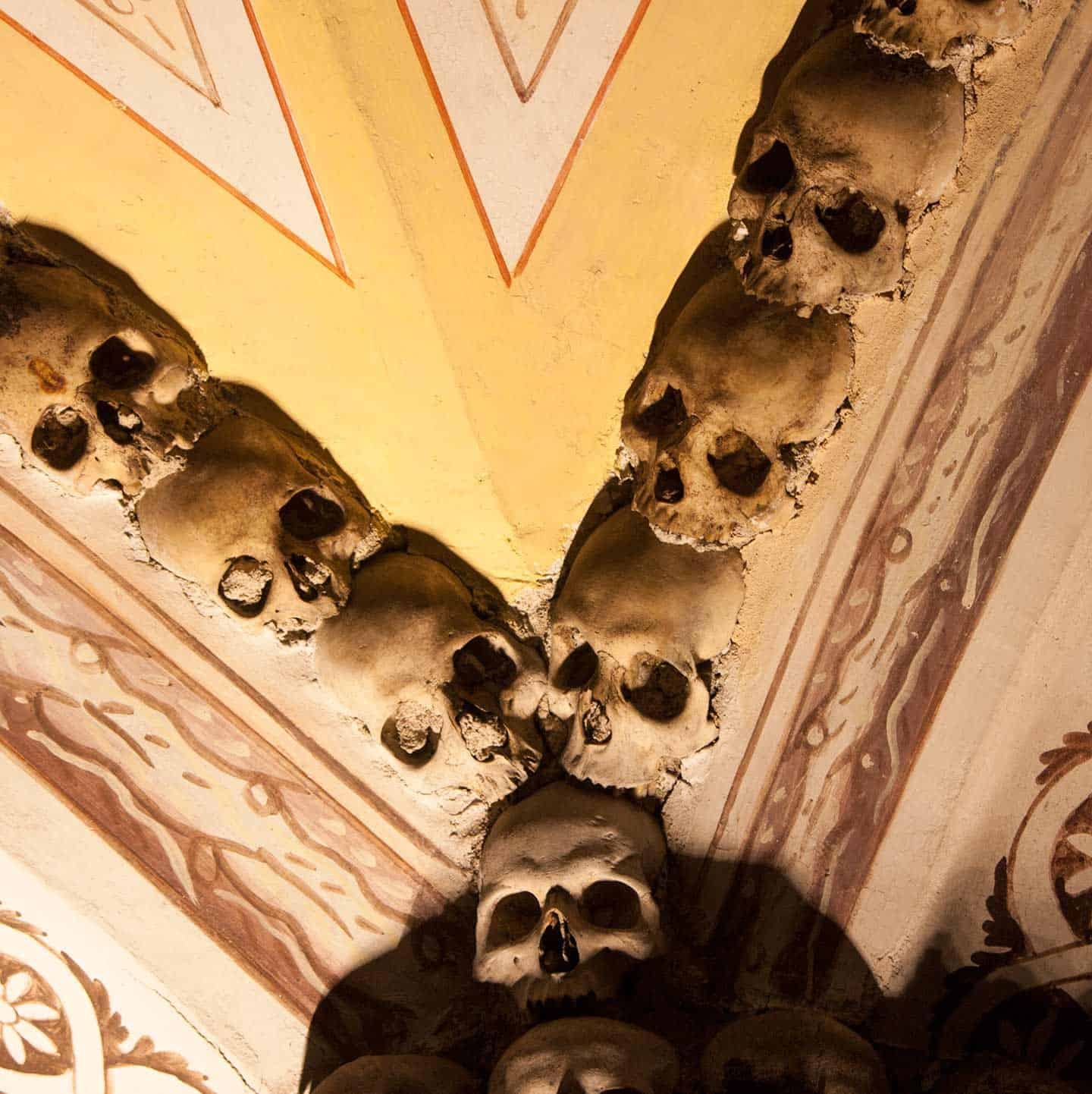 Image of seven skulls used for decoration on the ceiling of the chapel