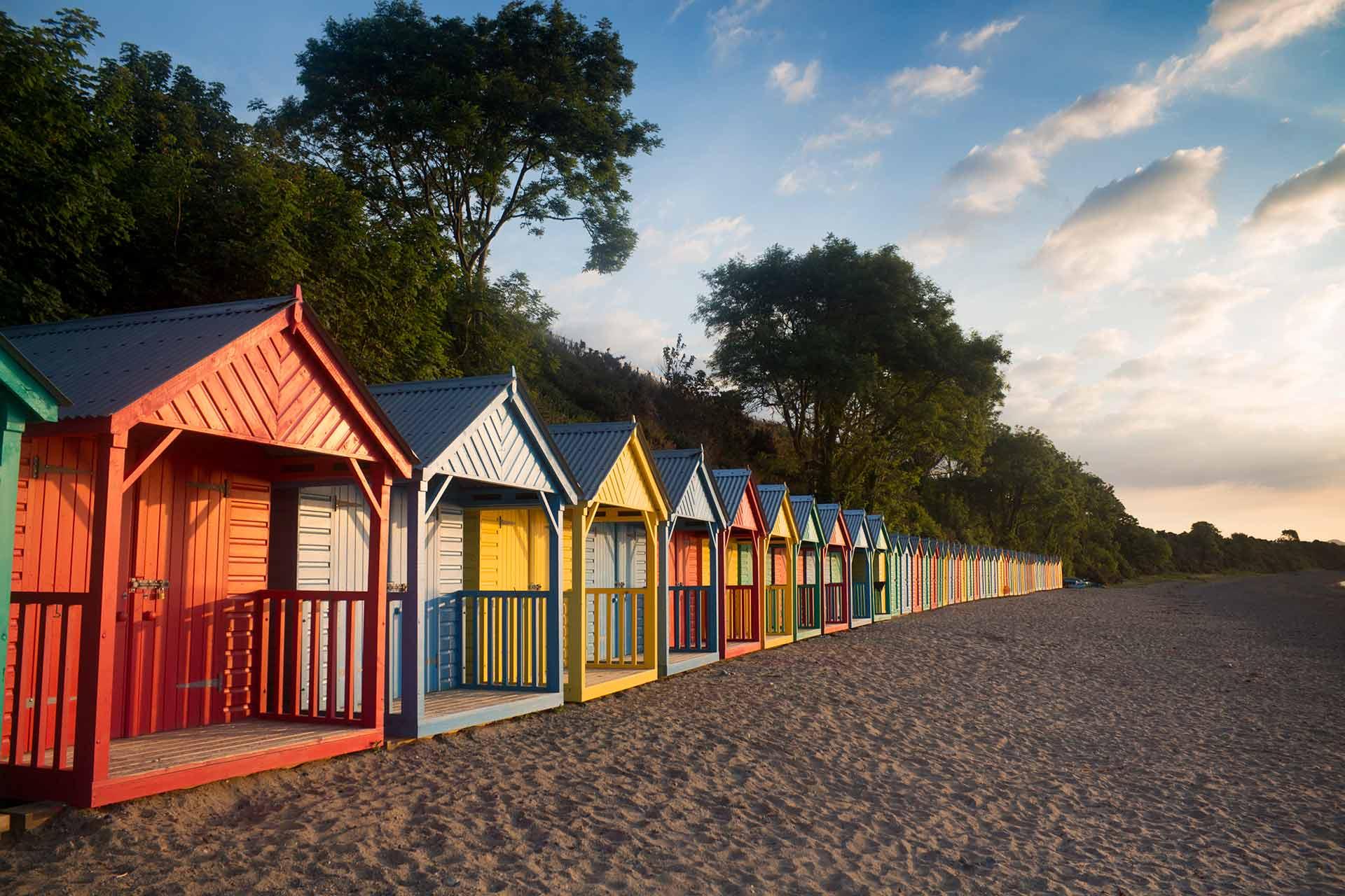 Llŷn Peninsula Beaches Image of beach huts at Llanbedrog Beach