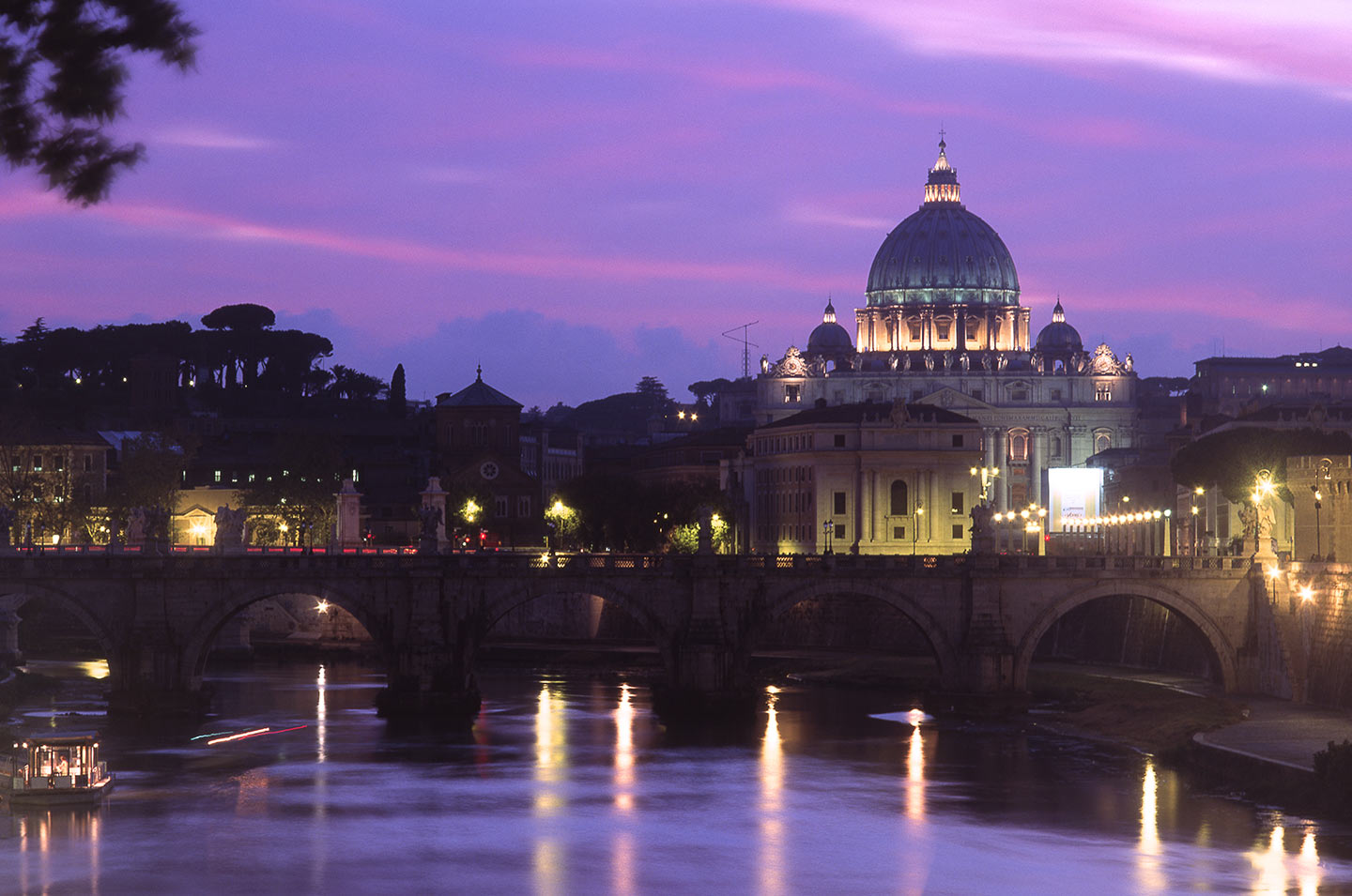 Image of St Peter's Basilica and the River Tiber at night, Rome