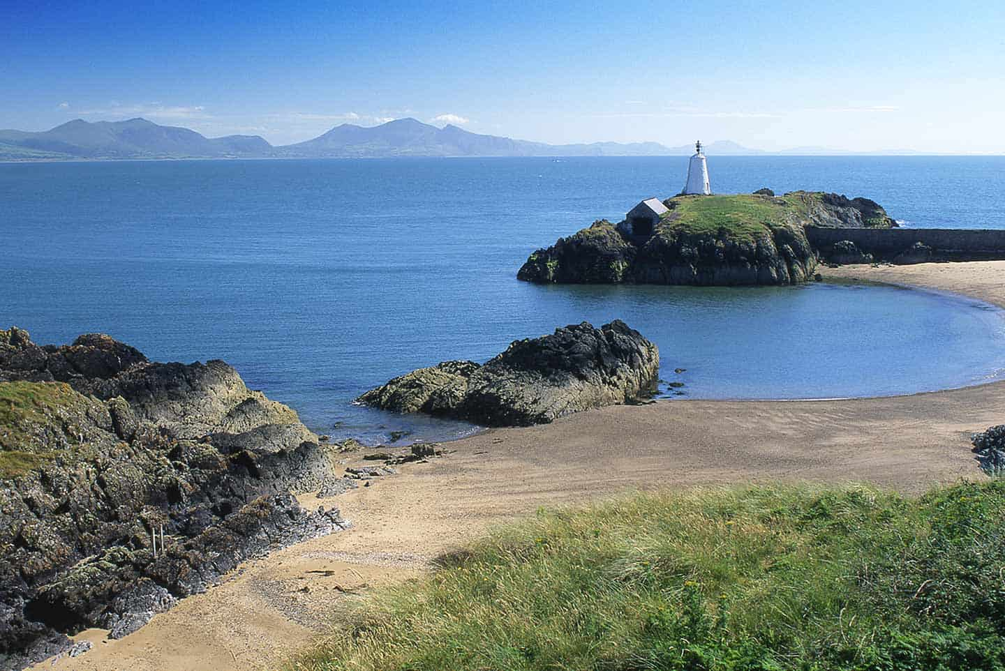Image of a beach and lighthouse on Llanddwyn Island