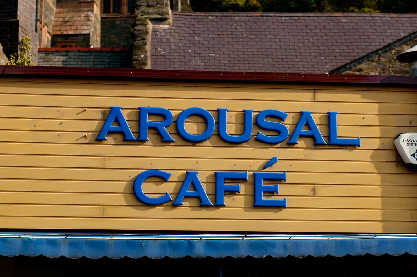 Image of humorous 'Arousal Cafe' sign in Barmouth