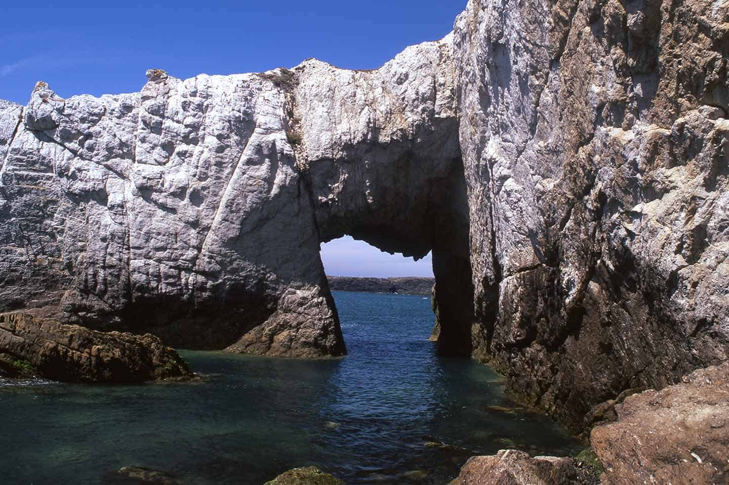 Image of Bwa Gwyn, the dramatic white arch near Rhoscolyn, Anglesey Wales UK