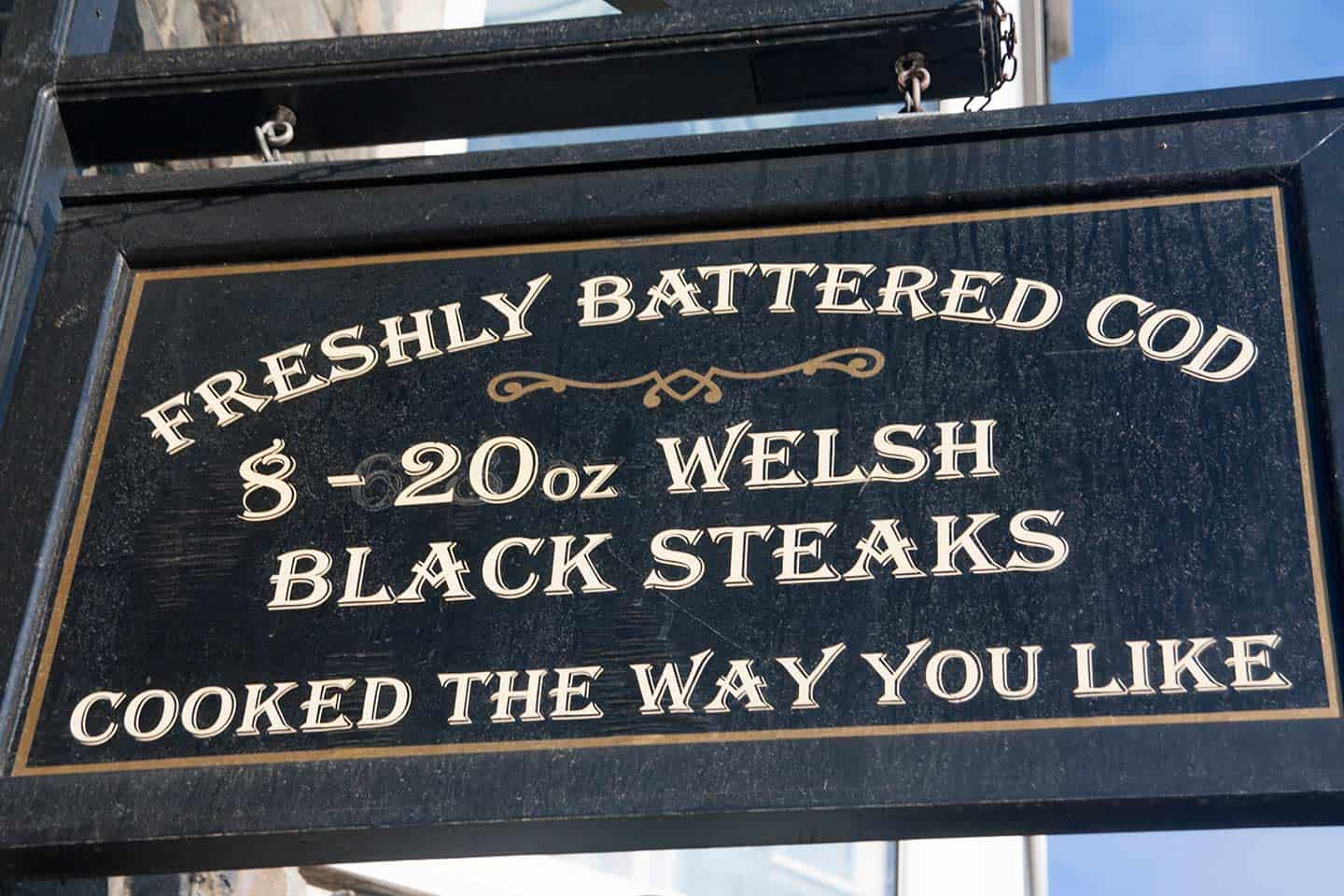 Image of sign mentioning Welsh black steaks outside restaurant in Barmouth, Wales
