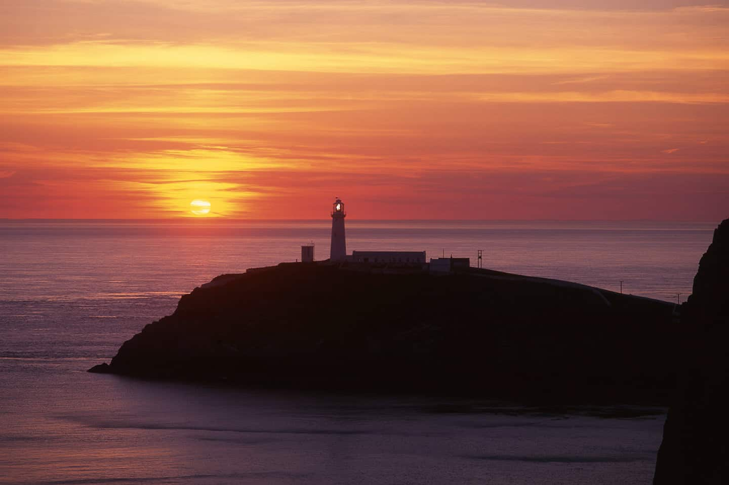 Image of sunset at South Stack lighthouse Anglesey