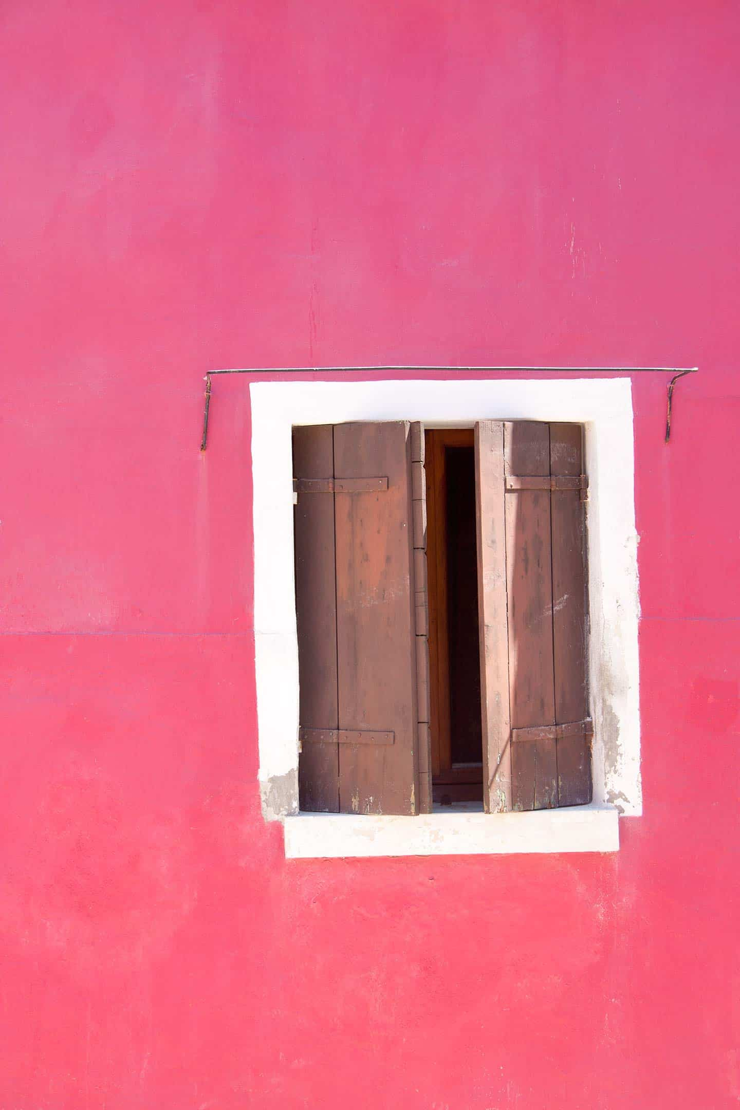 Image of a bright pink house in Burano Venice Italy