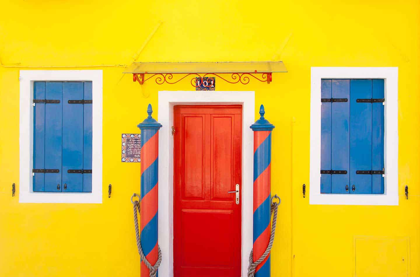 Image of a bright yellow house in Burano, Venice, Italy