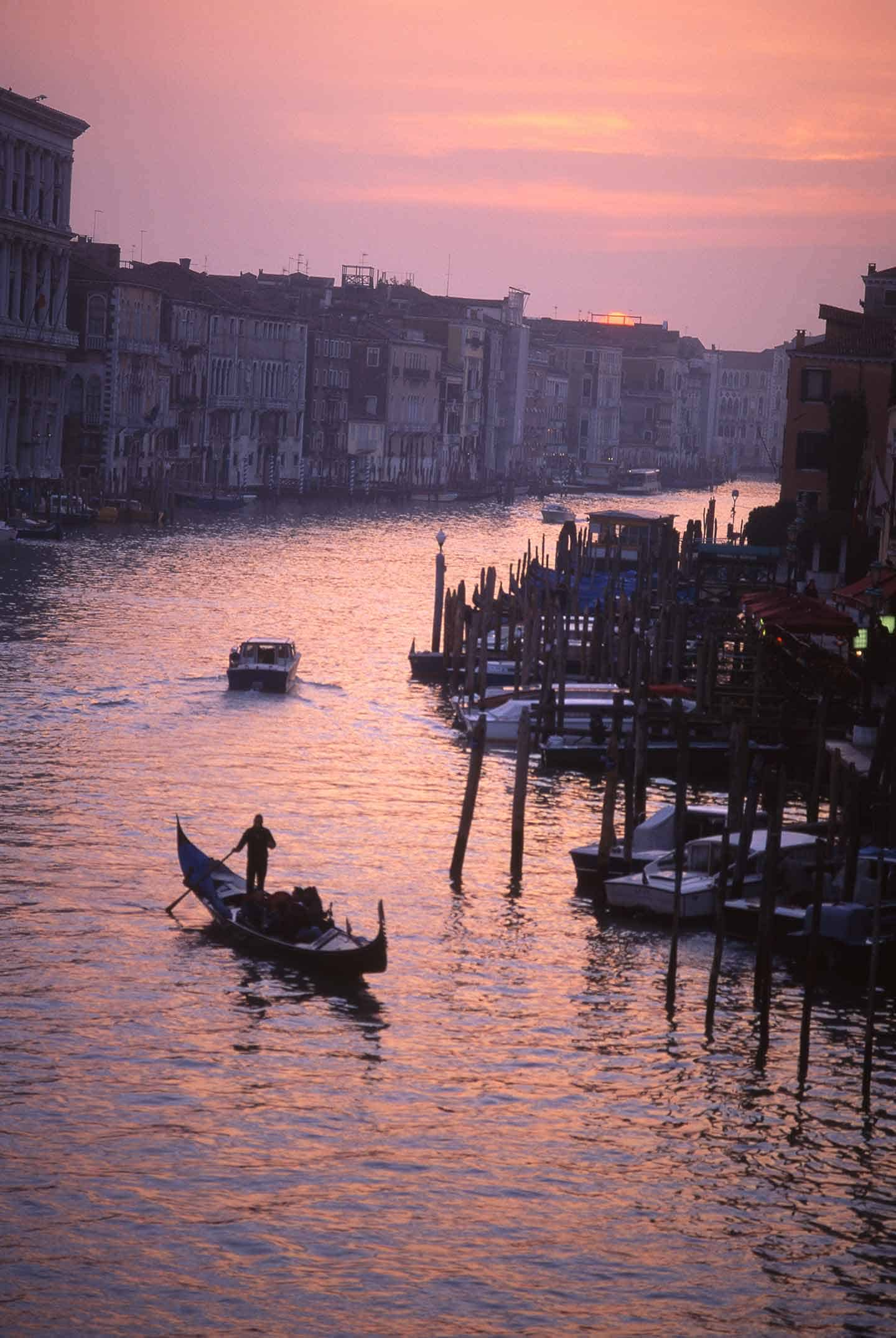 Image of a gondola on the Grand canal, Venice, at sunset