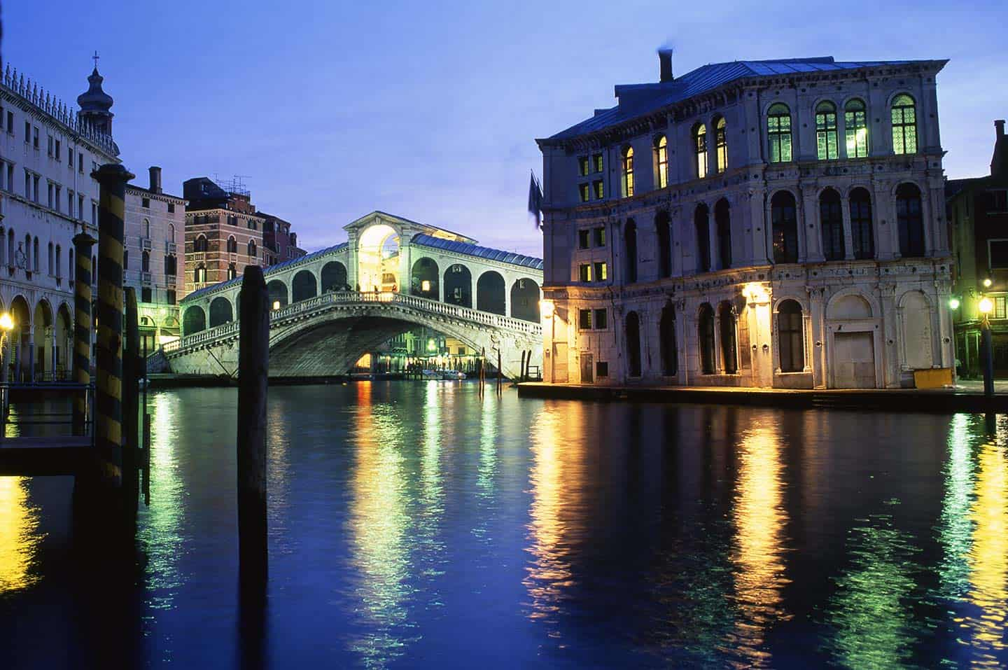 Image of the Rialto Bridge and Grand canal in Venice at night