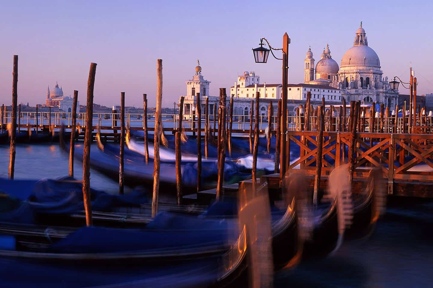 Image of Santa Maria della Salute and gondolas at sunrise, Venice Italy