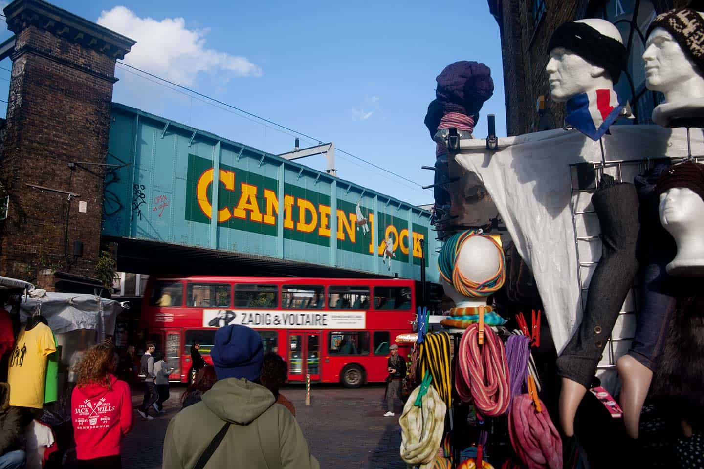 What to visit in London Image of Camden Lock bridge and market stalls