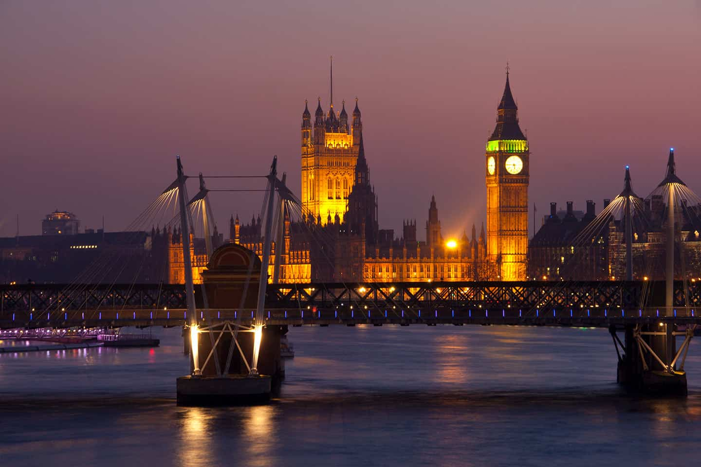 Image of the Hungerford and Golden Jubilee bridges  with the Houses of Parliament at dusk