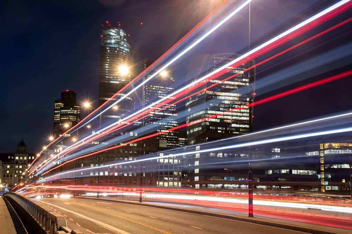 Image of a bus crossing London Bridge at night