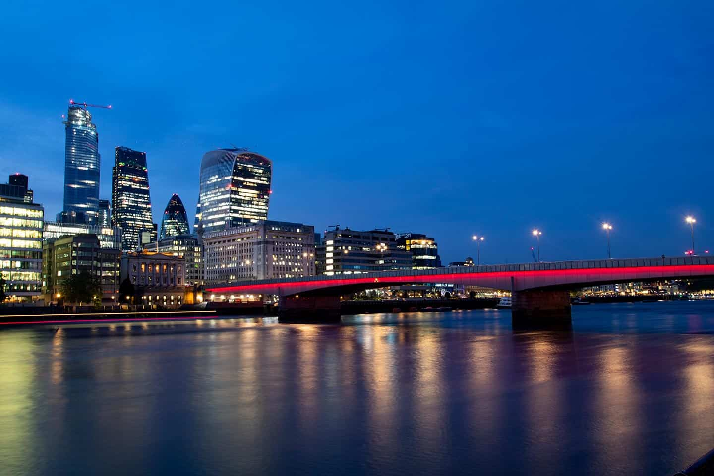 Image of London Bridge and the City of London at night