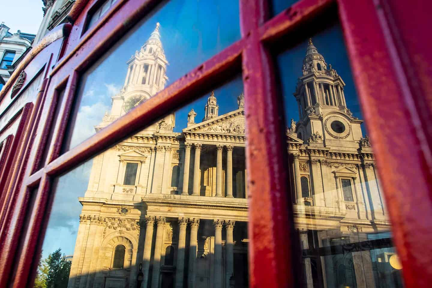 Image of St Paul's Cathedral reflected in a red telephone box