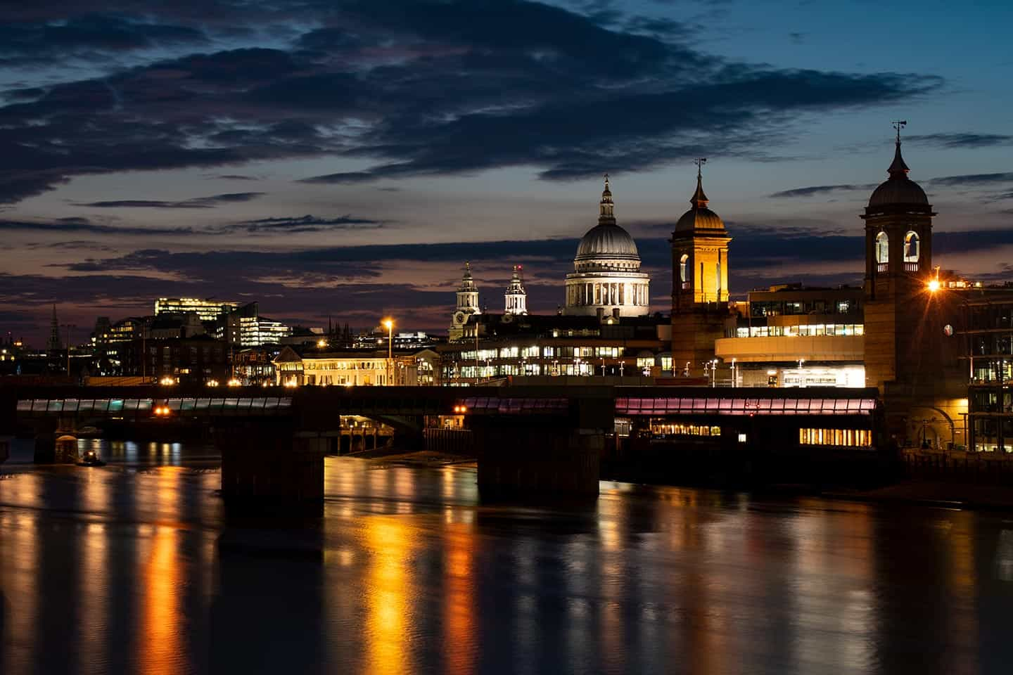 Image of St Paul's and the Cannon Street Railway Bridge, seen from London bridge at night