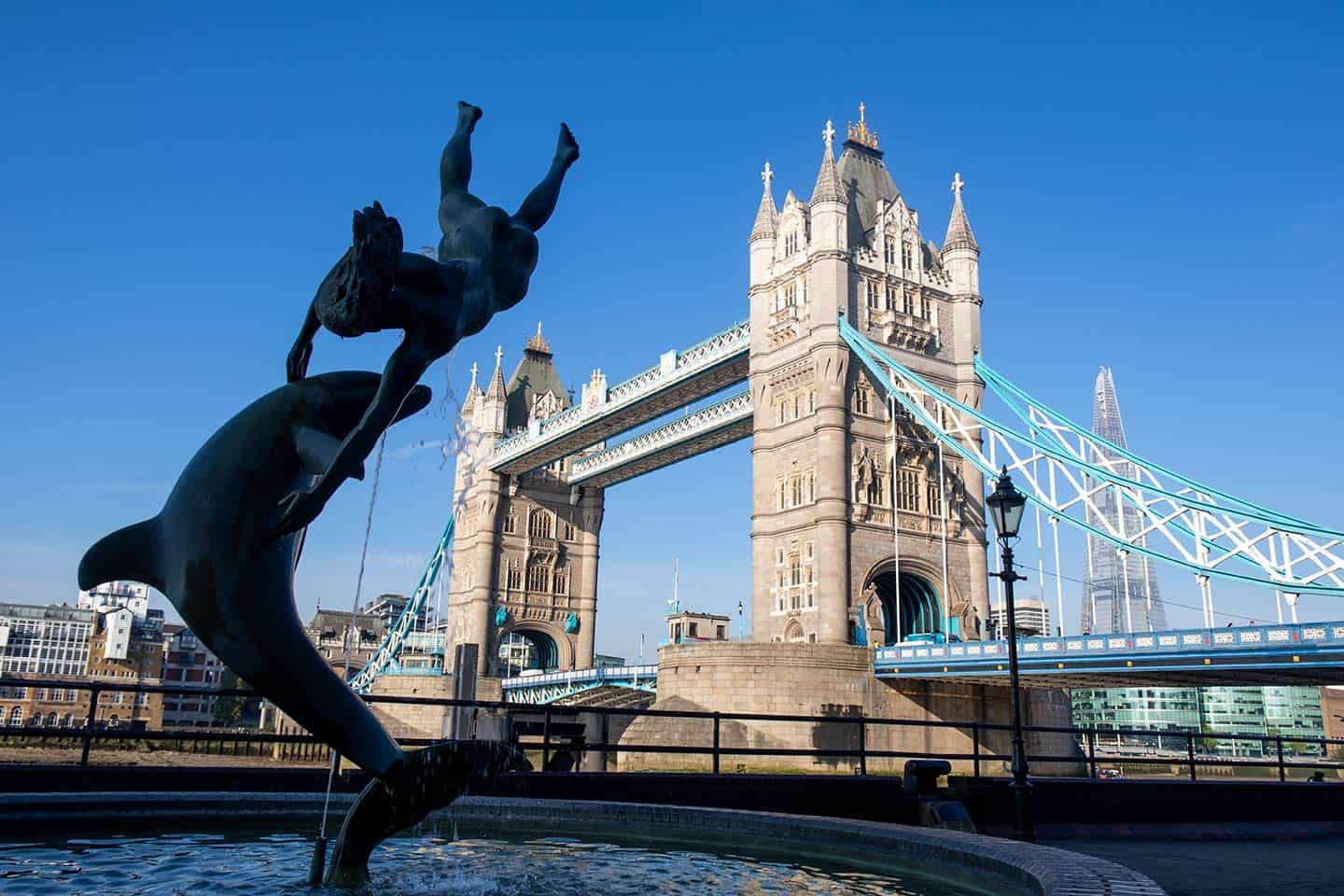 Image of Tower Bridge Londonand the famous Girl With A Dolphin sculpture