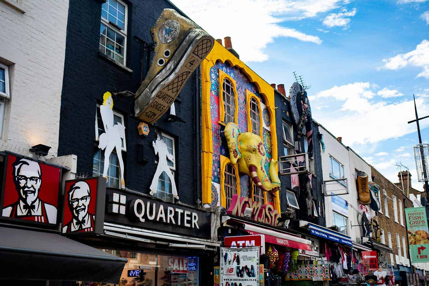 Image of the famous shop fronts on Camden High Street with sculptures of boots and elephants adorning the upper part of the buildings