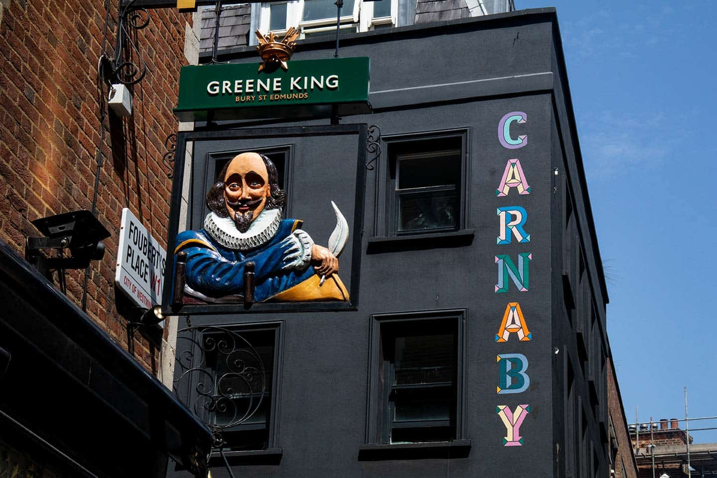Image of Shakespeare's Head pub sign and Carnaby Street sign, London
