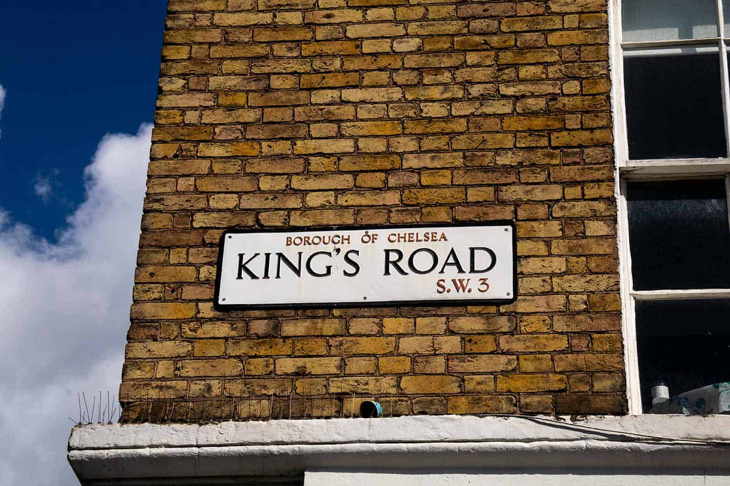 Image of a King's Road street sign in Chelsea, London