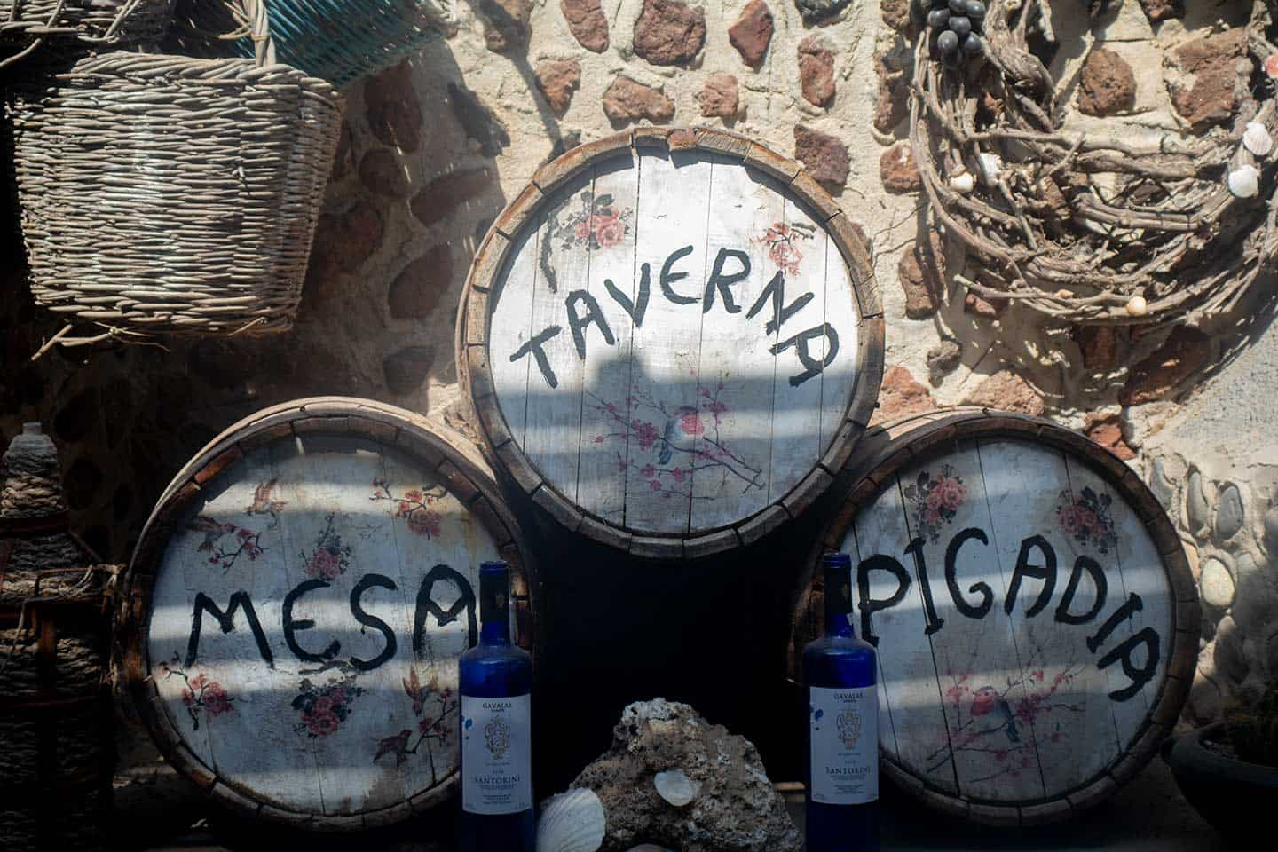 Image of wine barrels in the taverna at Black Beach