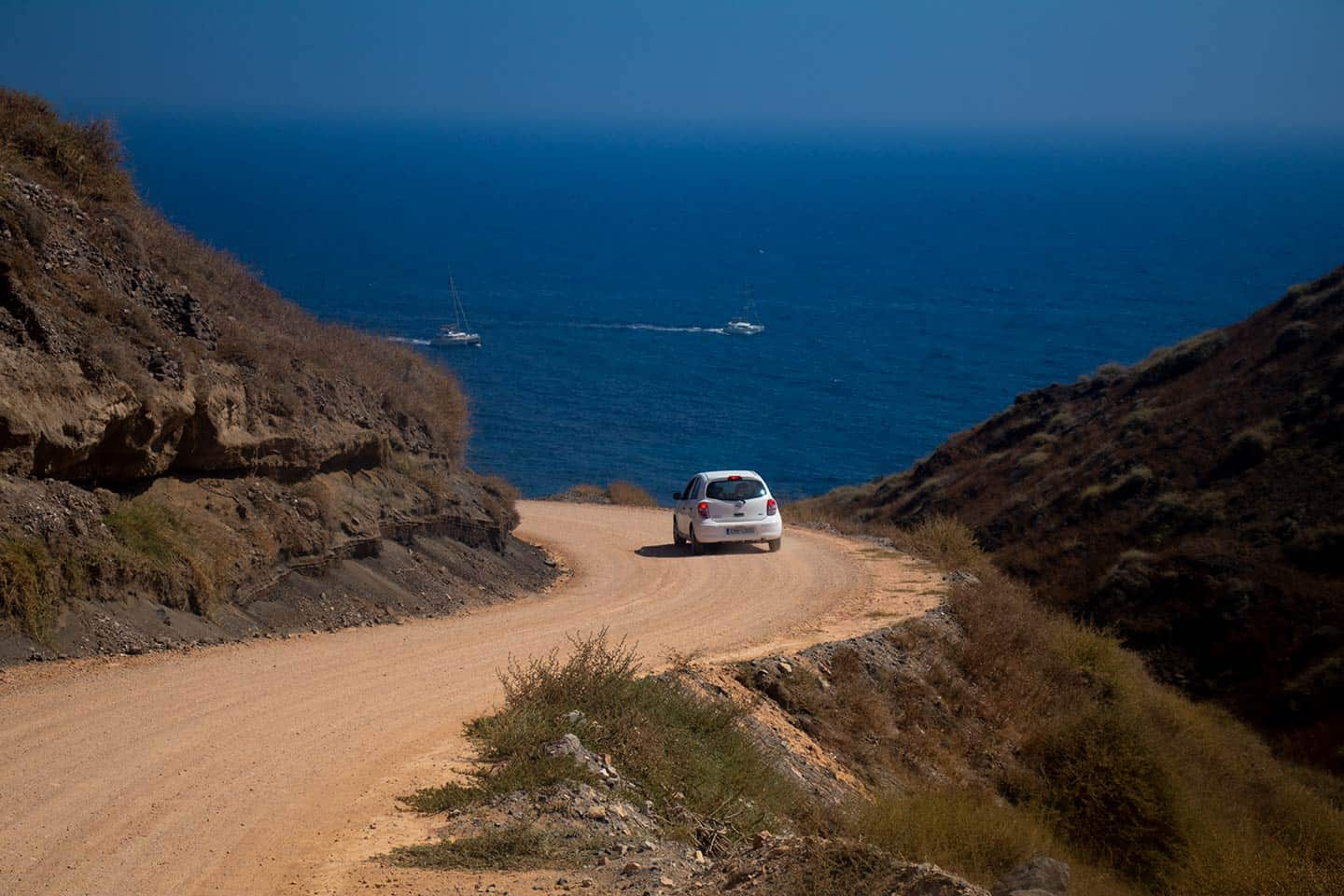 Image of a dirt road leading to Black Beach Santorini