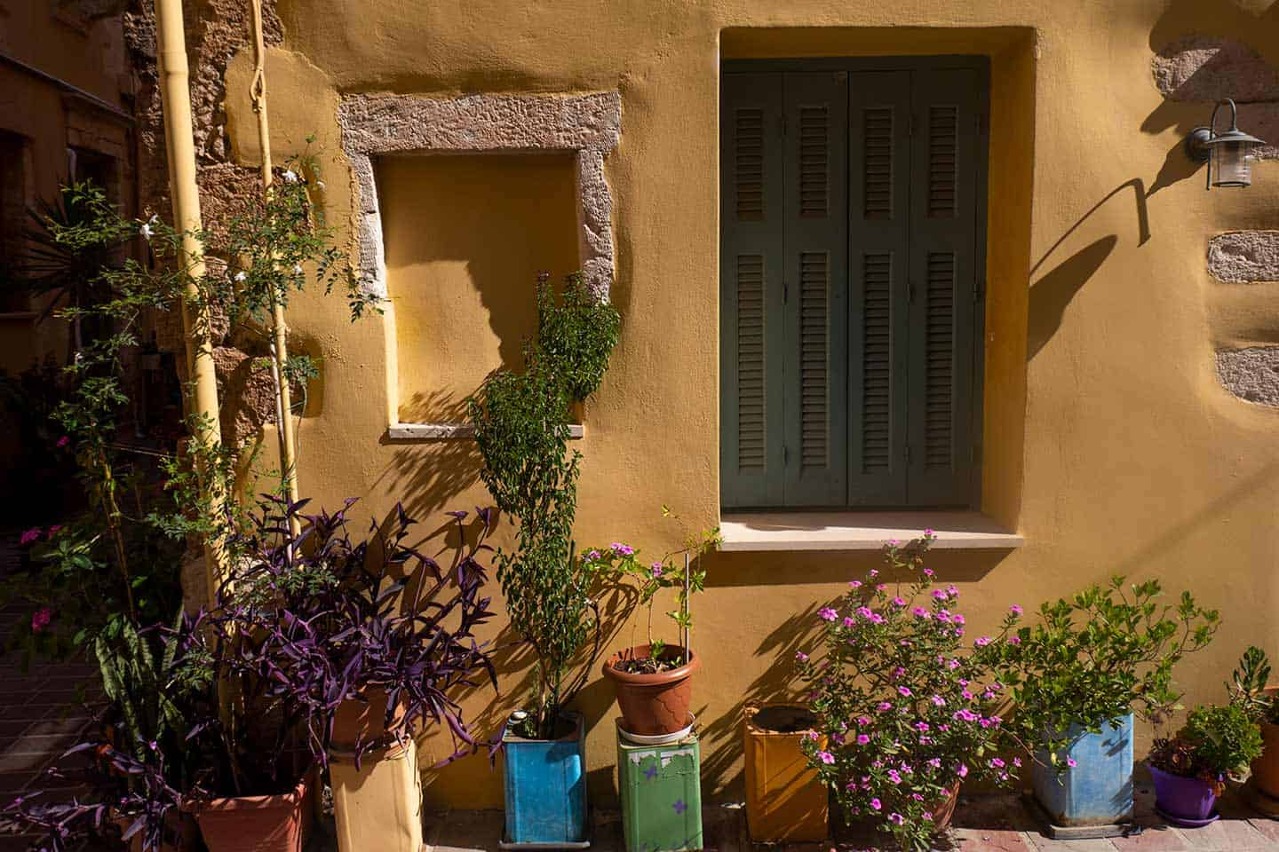 Image of a traditional house and flowerpots Chania Greece