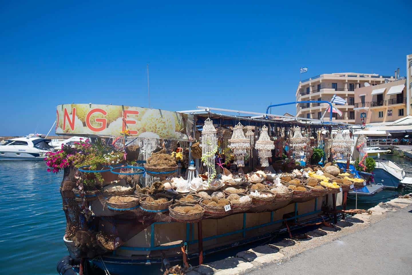 Image of a boat stall selling sea sponges in Chania harbour