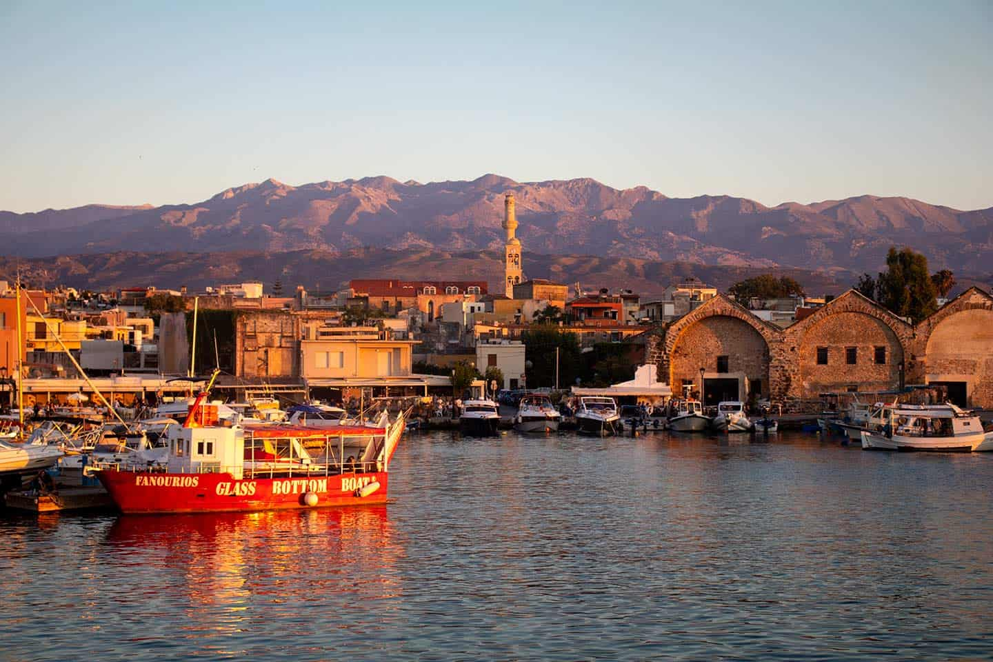 Image of the Venetian harbour and White Mountains Chania Crete Greece
