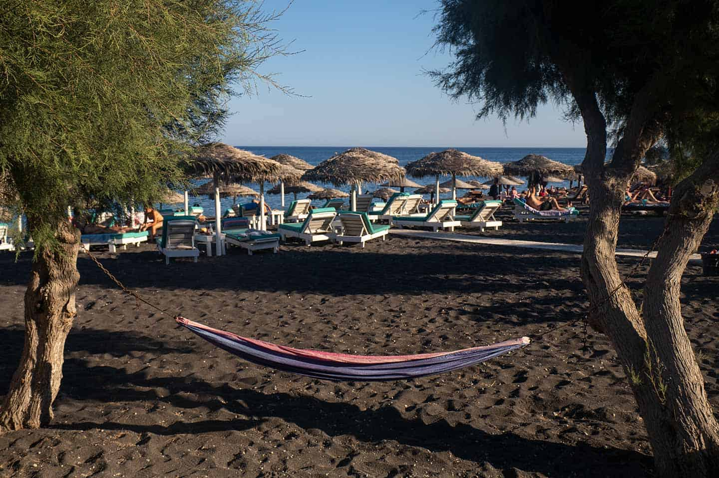 Image of a hammock on Perissa beach Santorini Greece