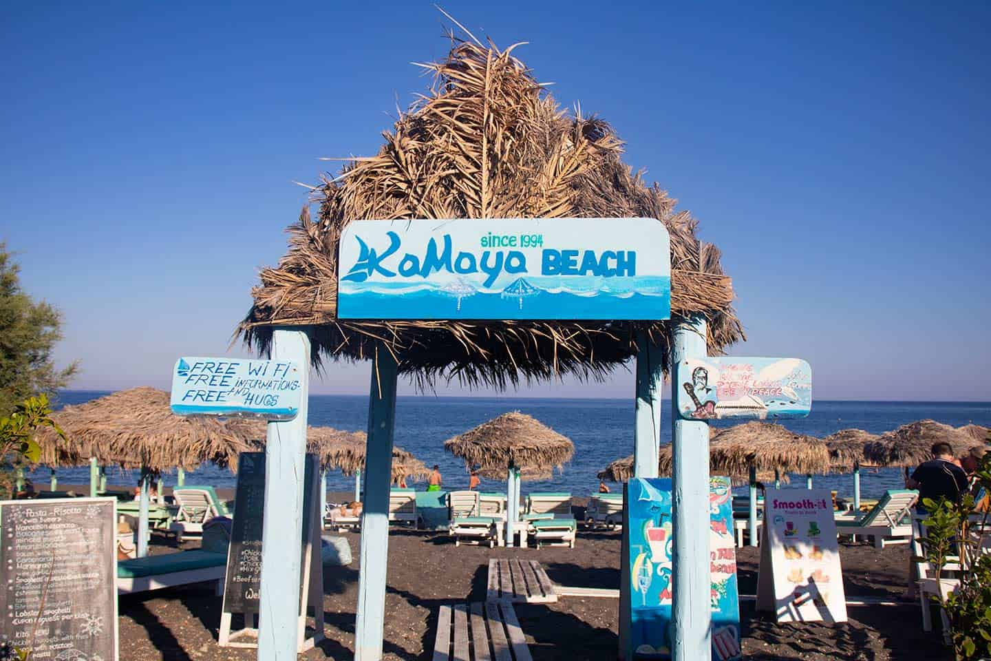 Image of the entrance to a section of Perissa beach Santorini