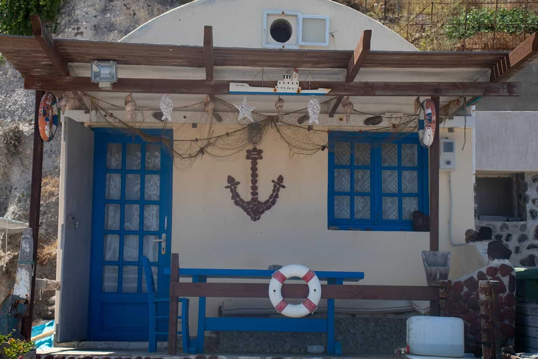 Image of a house on the shore of Caldera Beach in Santorini