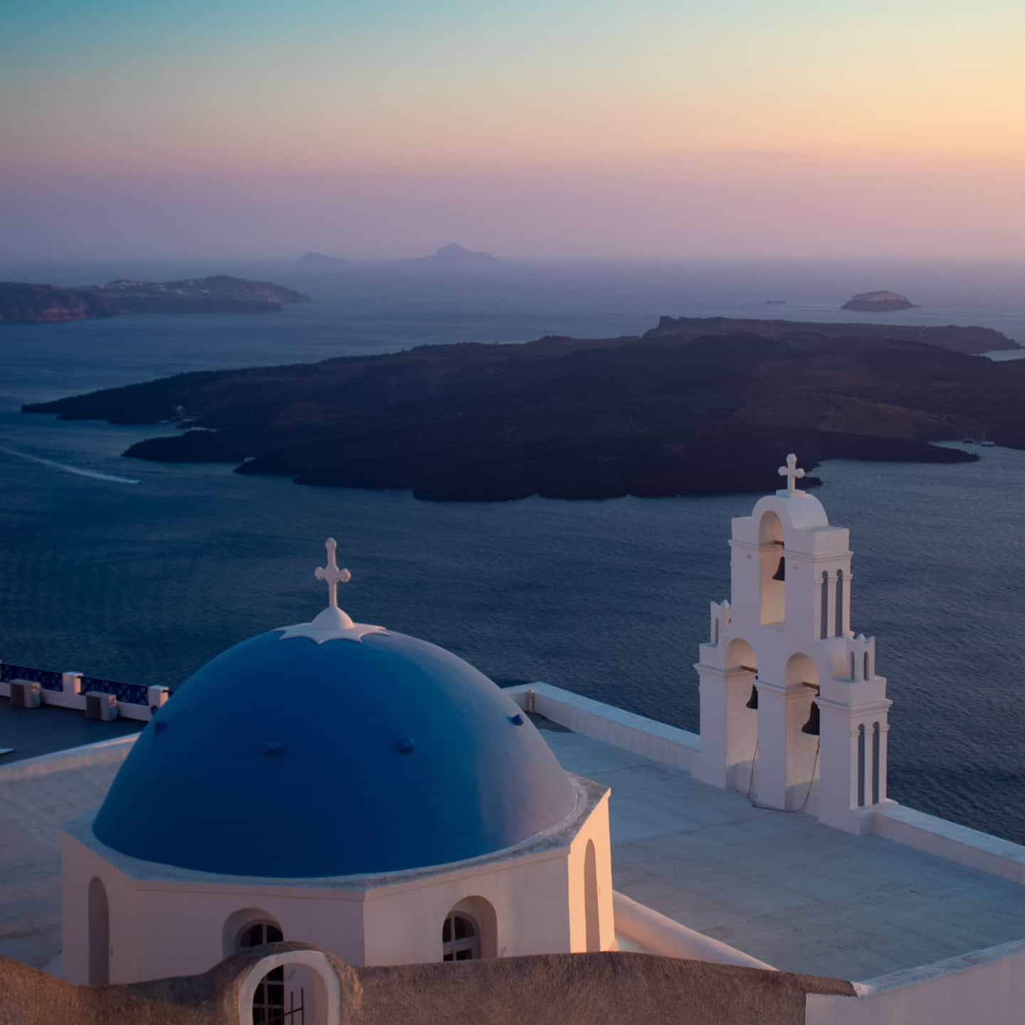 Image of the Three Bells of Fira church Santorini Greece at sunset