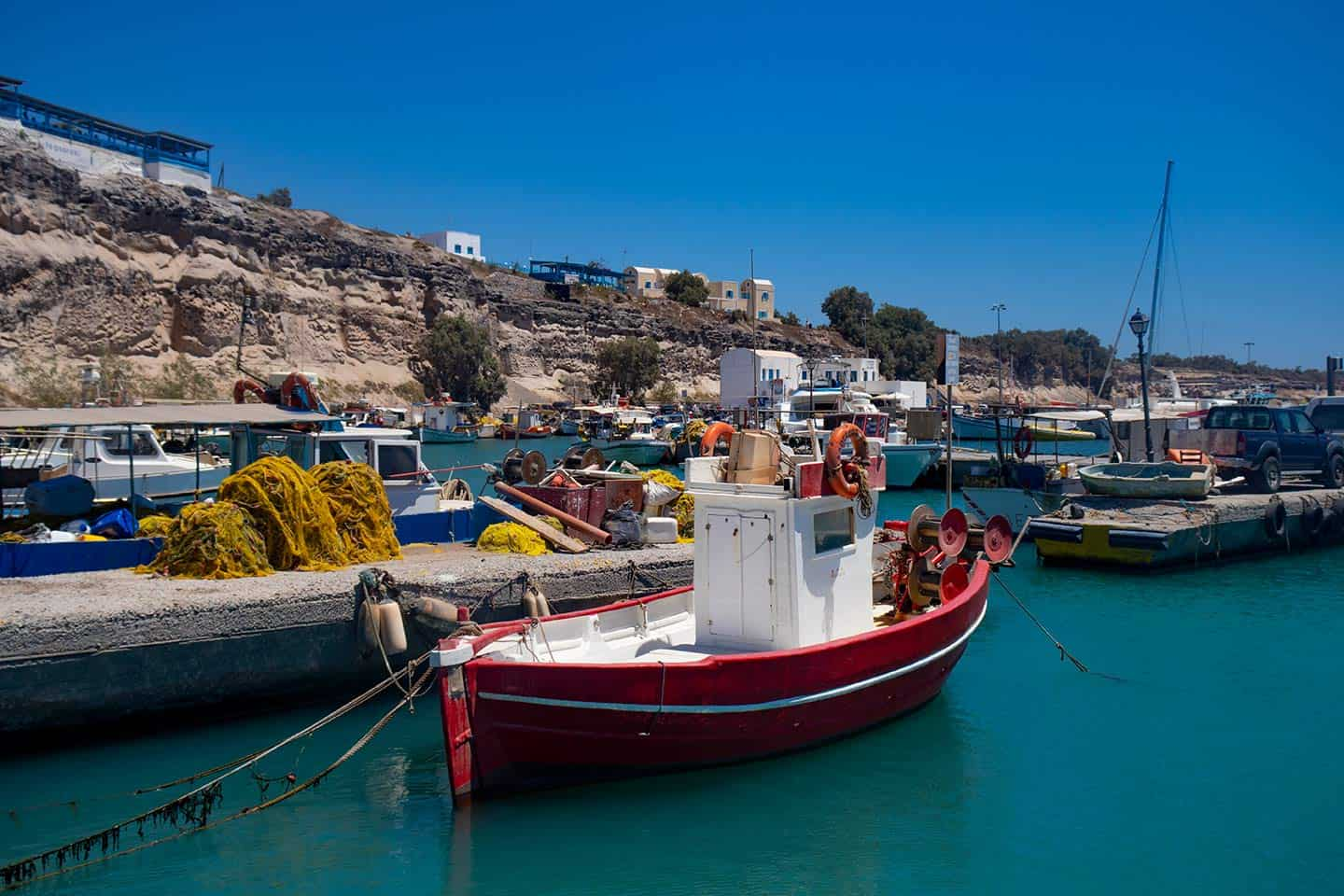 Image of fishing boats in the harbour at Vlychada, Santorini, Greece