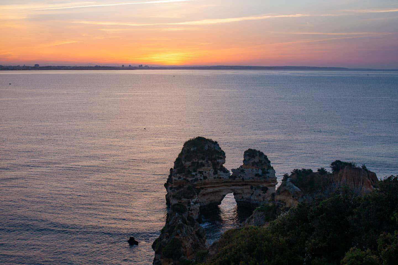 Image of rocks at Praia do Camilo beach, Lagos, Portugal,  at sunrise